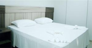 A bed or beds in a room at Hotel PetroShop