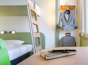 A bunk bed or bunk beds in a room at ibis Budget Essen Nord