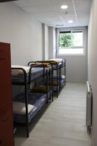 A bunk bed or bunk beds in a room at Albergue Bide-Ona