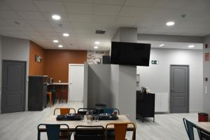 A television and/or entertainment center at Albergue Bide-Ona