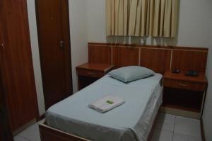 Cama ou camas em um quarto em Hotel Congonhas