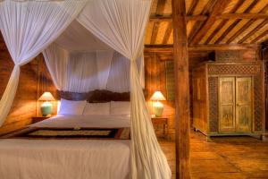 A bed or beds in a room at The Kampung