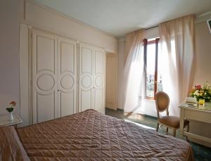 A bed or beds in a room at Grand Hotel Bonanno