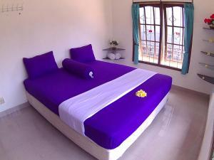 Ein Bett oder Betten in einem Zimmer der Unterkunft 24/7 Bed & Breakfast