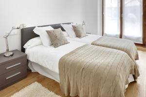 A bed or beds in a room at Cap 1500 by FeelFree Rentals