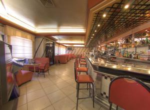 Un restaurante o sitio para comer en Hotel Avenida