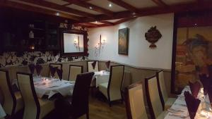 A restaurant or other place to eat at Locomotion Hotel