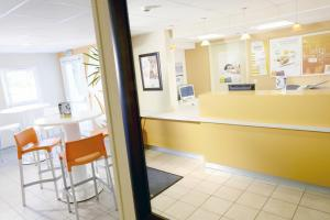 The lobby or reception area at Premiere Classe Pau Est-Bizanos