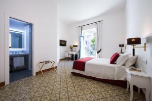 Letto o letti in una camera di Amalfi Luxury House