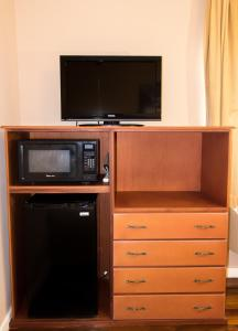 A television and/or entertainment center at The Durban Hotel Guyana INC.