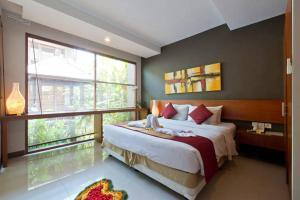 A bed or beds in a room at Casa Bidadari Suite & Apartment Seminyak