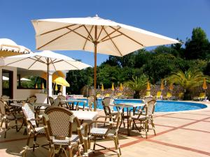The swimming pool at or near Hotel Casabela