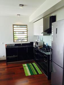 A cozinha ou cozinha compacta de Apartment Heitiare