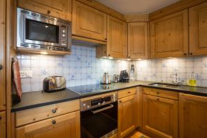 A kitchen or kitchenette at Residence Bastide