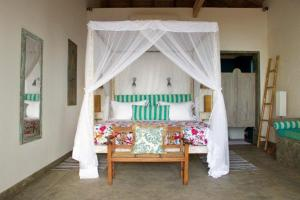A bed or beds in a room at Villa Nilaya