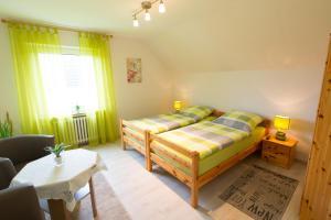 Кровать или кровати в номере Pension Hartenstein