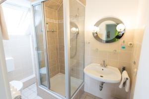 Ванная комната в Pension Hartenstein