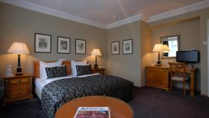 A bed or beds in a room at Apollofirst Boutique Hotel