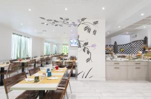 Ein Restaurant oder anderes Speiselokal in der Unterkunft c-hotels Atlantic