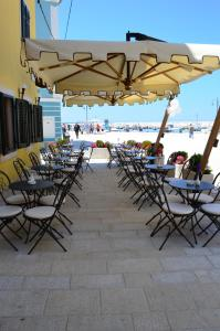Ein Restaurant oder anderes Speiselokal in der Unterkunft Villetta Phasiana