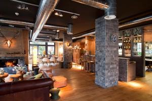 Salon ou bar de l'établissement Boutique-Hôtel Chez Jan