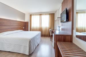 Um quarto em Hotel Laghetto Viverone Bento