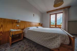 Кровать или кровати в номере Garnì Rosengarten