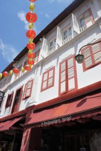Eine Fassade oder ein Eingang zu S Inn Chinatown (SG Clean)