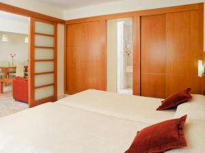 A bed or beds in a room at Hotel Principe Paz