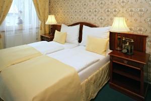Кровать или кровати в номере Hotel Mertin