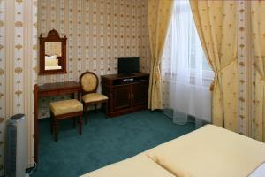 Телевизор и/или развлекательный центр в Hotel Mertin