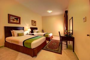 A bed or beds in a room at Asfar Resorts Al Ain