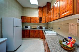 A kitchen or kitchenette at Asfar Resorts Al Ain