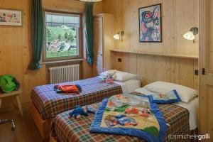 Postel nebo postele na pokoji v ubytování Art Apartments Casa Cambra