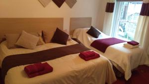 A bed or beds in a room at The White Swan - Swanage