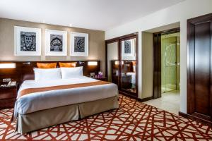 A bed or beds in a room at Crowne Plaza Dubai Deira, an IHG Hotel