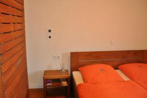 Ein Bett oder Betten in einem Zimmer der Unterkunft Gästehaus stuttgART36