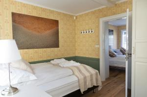 A bed or beds in a room at Briet Apartments