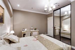 Кровать или кровати в номере Бутик Отель Дамари
