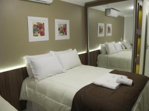 Cama ou camas em um quarto em Apartamento Centro Catedral