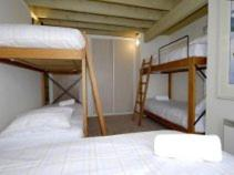 A bunk bed or bunk beds in a room at Twirligig
