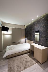 Ένα ή περισσότερα κρεβάτια σε δωμάτιο στο Castello City