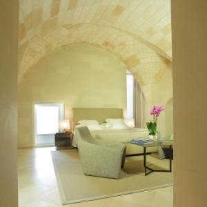 Letto o letti in una camera di La Fiermontina - luxury home hotel