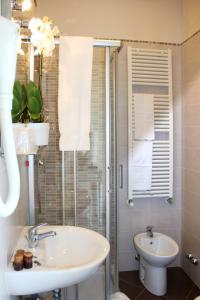 Um banheiro em Hotel Regit