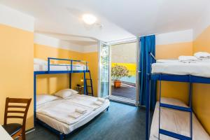 A bunk bed or bunk beds in a room at Pegasus Hostel Berlin