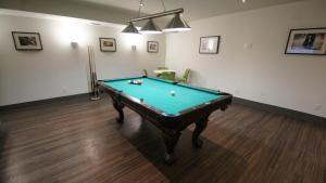 A pool table at HI Calgary City Centre Hostels