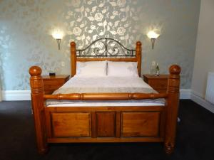A bed or beds in a room at Villa Shakespeare
