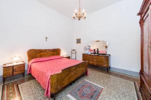 Cama o camas de una habitación en Appartamenti Chianti