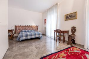 A bed or beds in a room at Appartamento Cittadella 39
