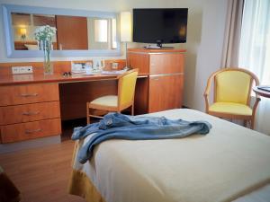 Telewizja i/lub zestaw kina domowego w obiekcie Hotel Nadmorski